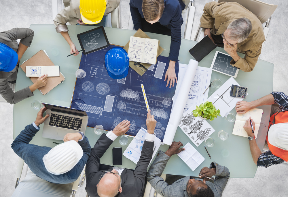 Architects planning at table